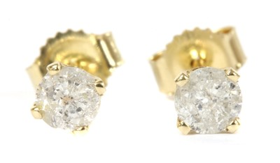 Lot 43 - A pair of gold single stone diamond stud earrings