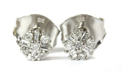 Lot 87 - A pair of white gold diamond cluster stud earrings