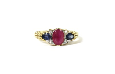 Lot 117 - An 18ct gold ruby, sapphire and diamond ring