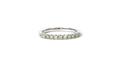 Lot 71 - A 9ct white gold diamond half eternity ring