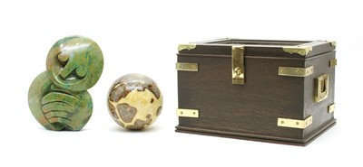Lot 39 - A decorative stone orb and an African greenstone sculpture