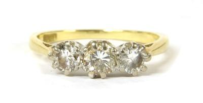 Lot 45 - A gold three stone diamond ring
