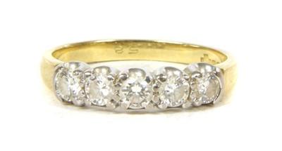 Lot 50 - An 18ct gold five stone diamond ring