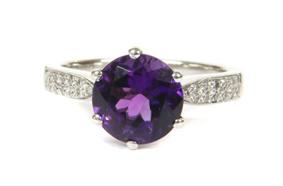 Lot 155 - An 18ct white gold amethyst and diamond ring