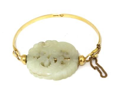 Lot 99 - A Chinese jade and gold bangle
