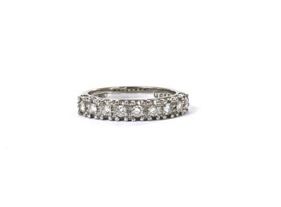 Lot 72 - A white gold nine stone diamond ring