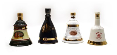 Lot 102 - Bells assorted commemorative whisky decanters of various size