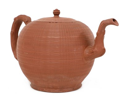 Lot 106 - A rare Staffordshire redware globular punch pot and cover