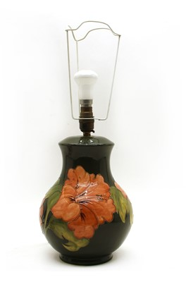 Lot 48 - A Moorcroft tubeline decorated 'Hibiscus' pattern table lamp