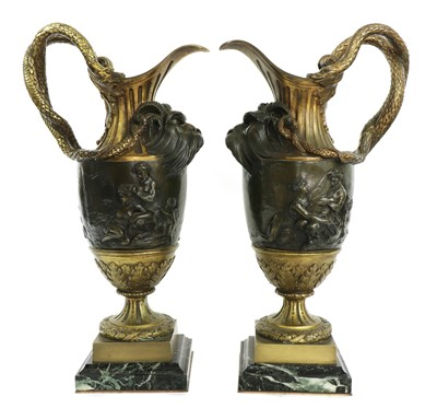 Lot 481 - A pair of large gilt-bronze and bronze ewers