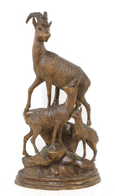 Lot 520 - A Black Forest carved linden wood figure group of mountain goats