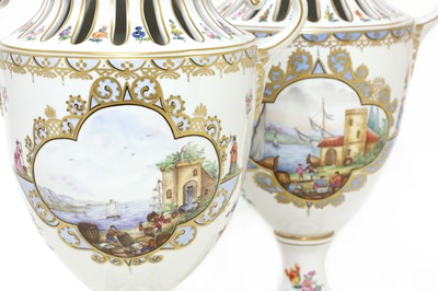 Lot 92 - A pair of Dresden urn vases and covers