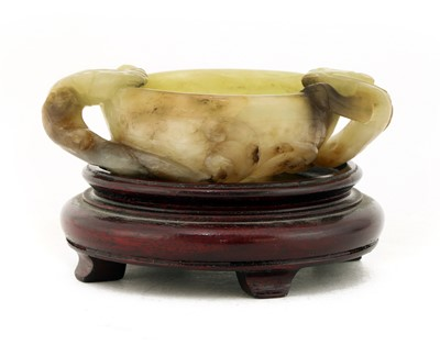 Lot 82 - A Chinese jade two-handled cup
