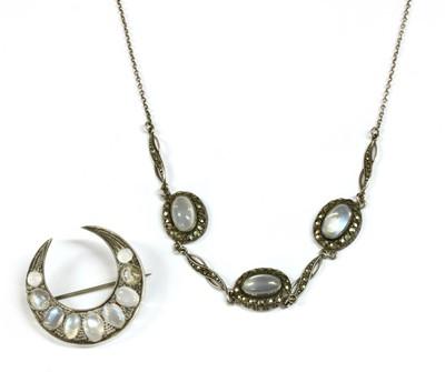 Lot 33 - An Edwardian silver moonstone crescent brooch