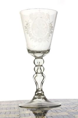 Lot 151 - A Dutch engraved royal armorial goblet