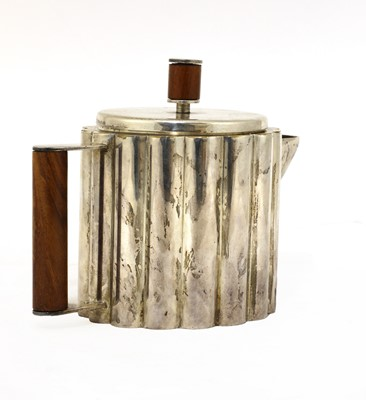 Lot 244 - A Paye & Baker Art Deco silver-plated teapot