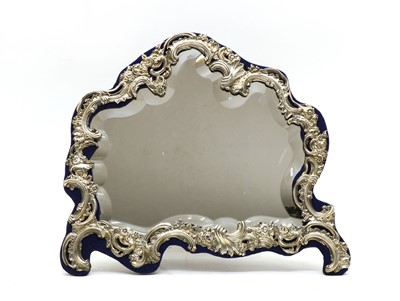 Lot 35 - A silver framed dressing mirror of Rococo design