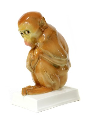 Lot 104 - A porcelain figure of a monkey