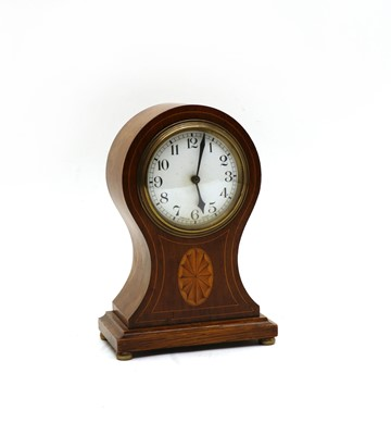 Lot 46 - An Edwardian mantel clock and an oak tray