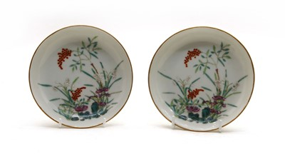 Lot 106 - A pair of Chinese famille rose saucers