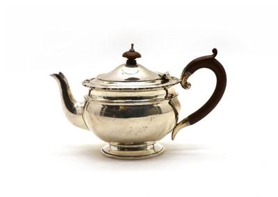 Lot 26 - A George V silver teapot