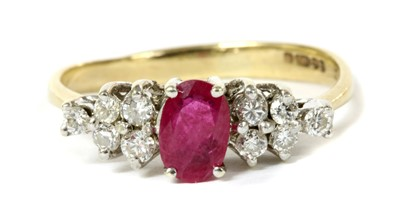 Lot 110 - A 9ct gold ruby and diamond eleven stone ring