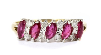 Lot 109 - A 9ct gold ruby and diamond half eternity ring