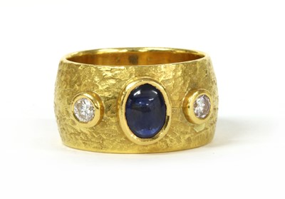 Lot 160 - A gold sapphire and diamond three stone band ring