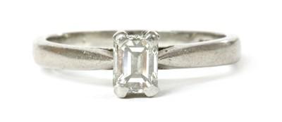 Lot 112 - A platinum single stone emerald cut diamond ring