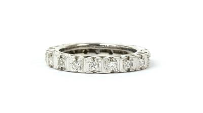 Lot 73 - A white gold diamond set full hoop pendant or full eternity ring