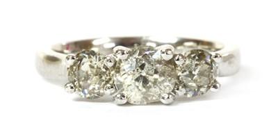 Lot 70 - An 18ct white gold three stone diamond ring