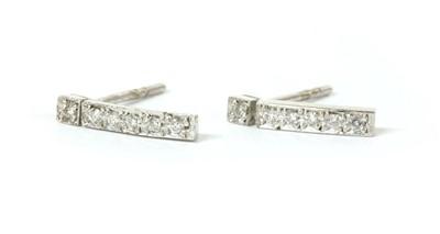 Lot 81 - A pair of 18ct white gold diamond set bar earrings
