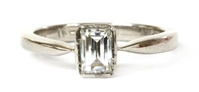 Lot 77 - A white gold single stone emerald cut diamond ring