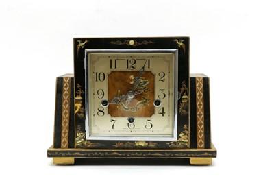 Lot 88 - A black lacquered mantel clock