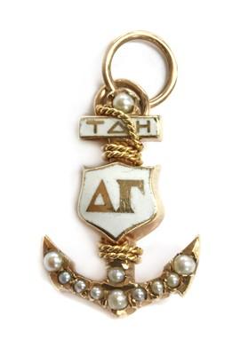 Lot 18 - An American gold enamel and split pearl Delta Gamma sorority charm