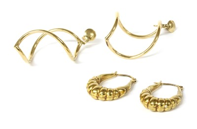 Lot 102 - A pair of gold hollow twist form drop earrings