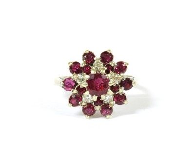 Lot 111 - A 9ct white gold ruby and diamond cluster ring