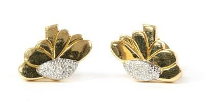Lot 58 - A pair of 18ct gold diamond set daisy stud earrings