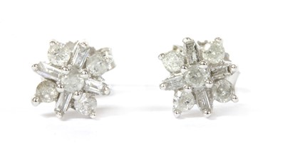 Lot 86 - A pair of white gold diamond cluster earrings