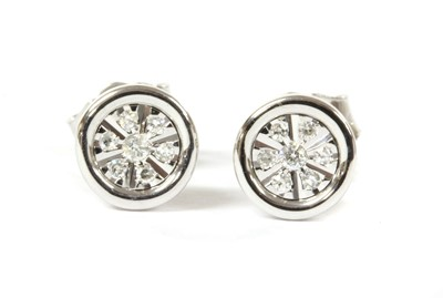 Lot 93 - A pair of white gold diamond earrings