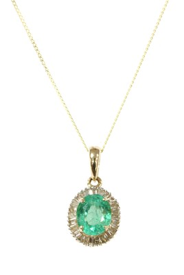 Lot 121 - A gold emerald and diamond cluster pendant