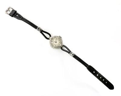 Lot 170 - A ladies' 18ct white gold diamond set Vertex mechanical strap watch, c.1930