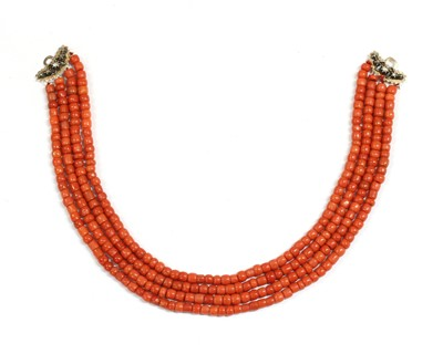Lot 26 - A four row coral bead necklace