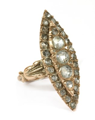 Lot 7 - An early 20th century gold navette shaped diamond cluster ring