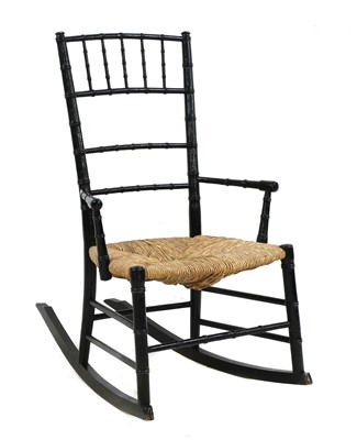 Lot 22 - An Aesthetic ebonised child's rocking chair