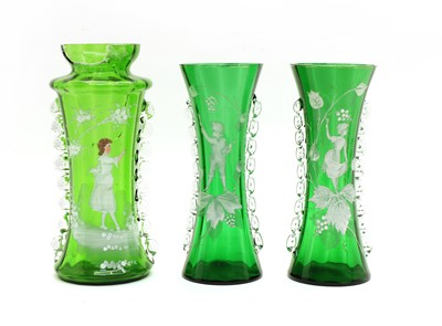 Lot 63 - A pair of large green 'Mary Gregory' vases