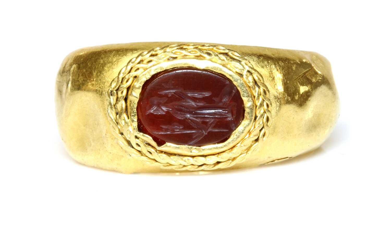 Lot 5 - A Roman gentlemen's high carat gold cornelian intaglio ring