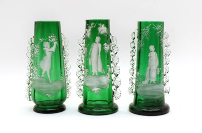 Lot 115 - A pair of green 'Mary Gregory' glass vases