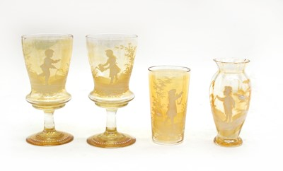 Lot 92 - A quantity of amber glass 'Mary Gregory' items