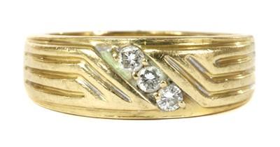 Lot 49 - A gold three stone diamond ring